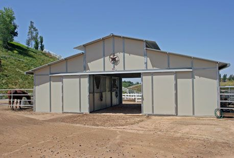 Titan steel and wood wall system steel horse barns for Hay pole barns