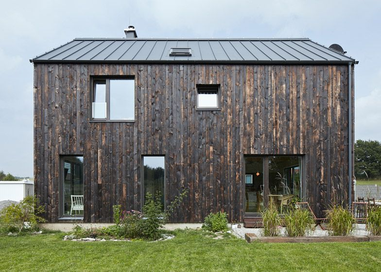 Carbon House Is Clad With Vertical Timber Planks That Have Only