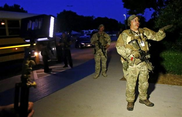 Two gunmen were shot dead May 3 and a security guard wounded outside a Prophet Mohammed cartoon contest in Texas, authorities said, as a bomb squad investigated the gunmen's car.