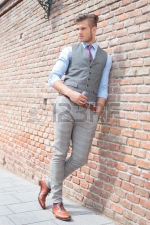 Full Length Picture Of A Casual Young Man Leaning On A Brick Photography Poses For Men Male Models Poses Poses For Men