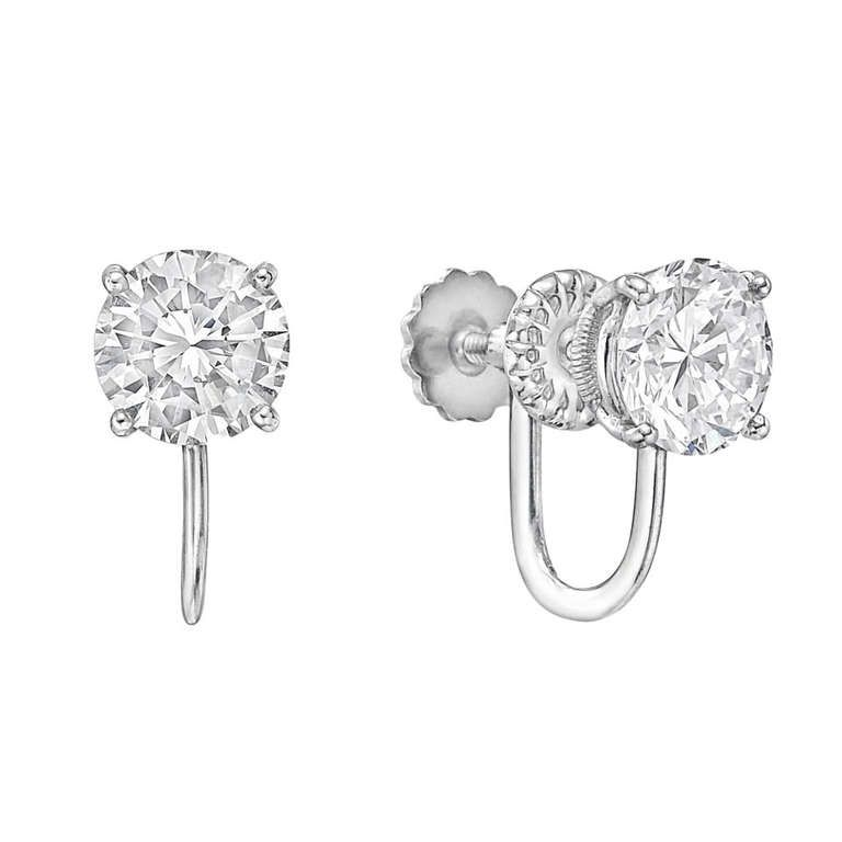 Diamond earclips, showcasing a pair of round brilliant cut diamonds weighing 1.43 and 1.42 carats, respectively, prong-set in 14k white gold screw-in clip backs, both earrings signed Cartier. Accompanied by GIA certificates for either diamond. - $42,000