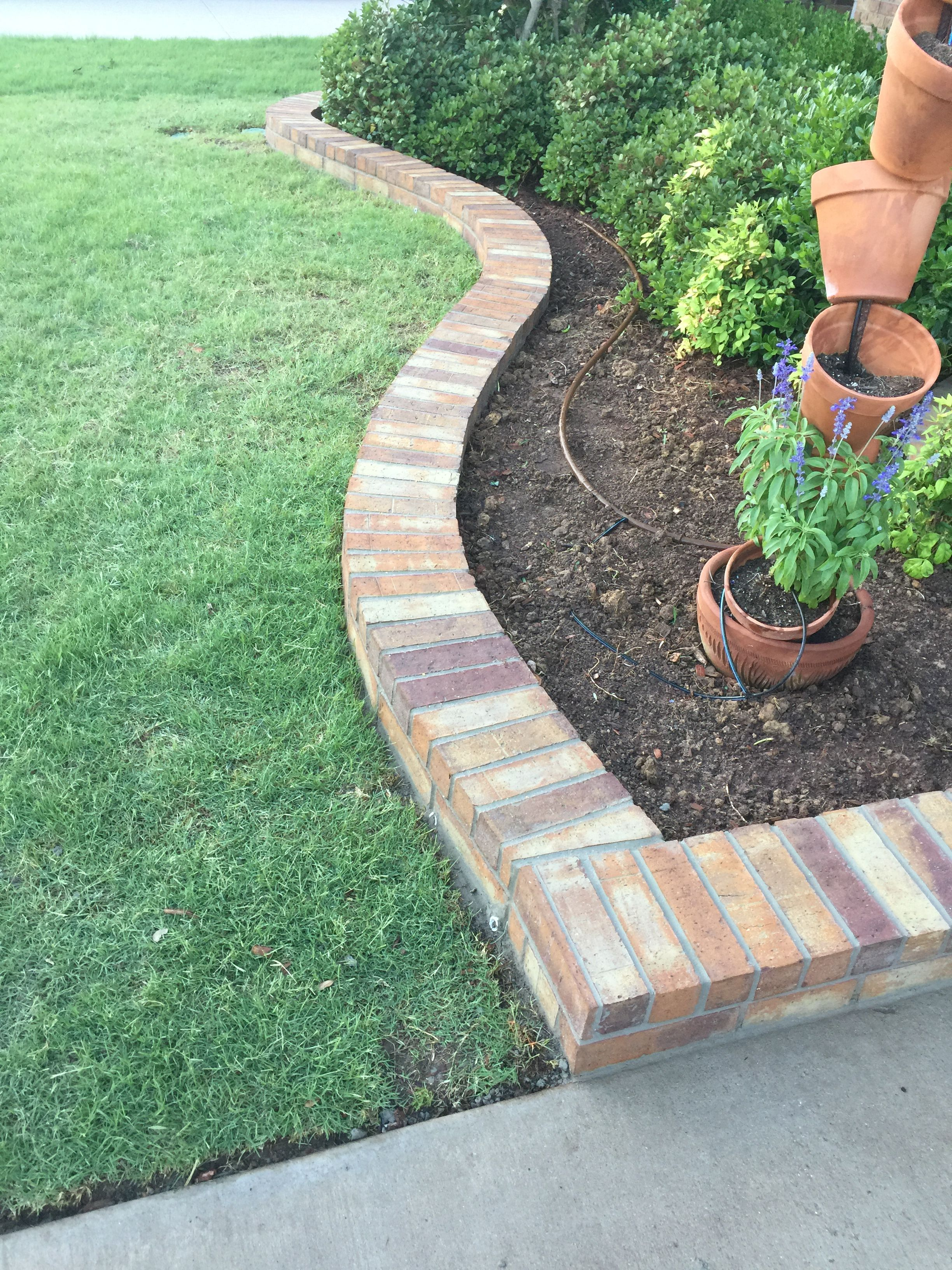 Here We Have A Beautiful Brick Flowerbed Border Groundscape Installed In Argyle Texas If You Would Lik Brick Garden Edging Brick Landscape Edging Brick Garden