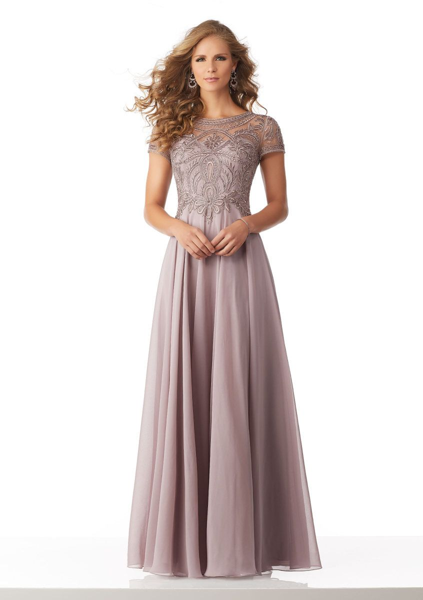 a0b7c85eb7e MGNY by Morilee 71824 is a short sleeve Chiffon mother of the bride Gown  that has an Intricately Beaded and Embroidered Net Bodice with beautiful  Illusion ...