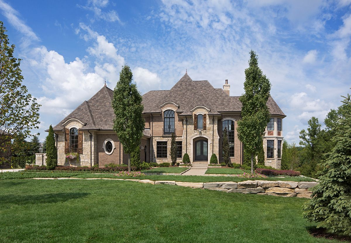 lovely European home with brick and stone