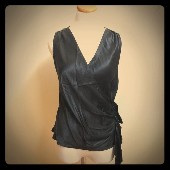 100% Silk Drapey Black Top Soft silk blouse.  Hidden zipper in the side, with ruffle detail on one side. There is a button on the inside of where the bust crosses over to prevent anything popping out.  Label says size 8 but fits like a 4-6.  Great condition! Tops