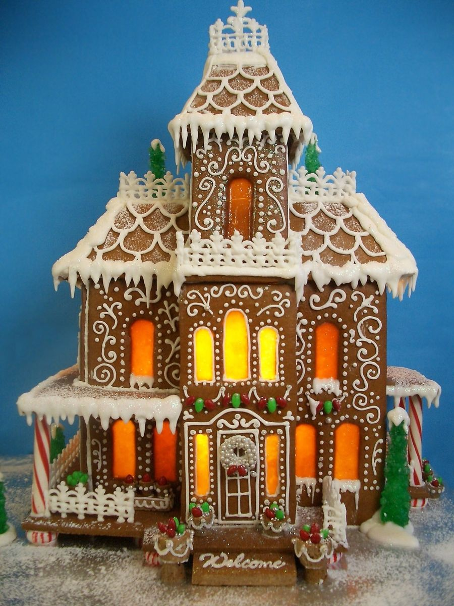 Victorian Gingerbread Mansion This Years Gingerbread Mansion Is Decorated With Royal I Gingerbread House Template Gingerbread House Christmas Gingerbread House