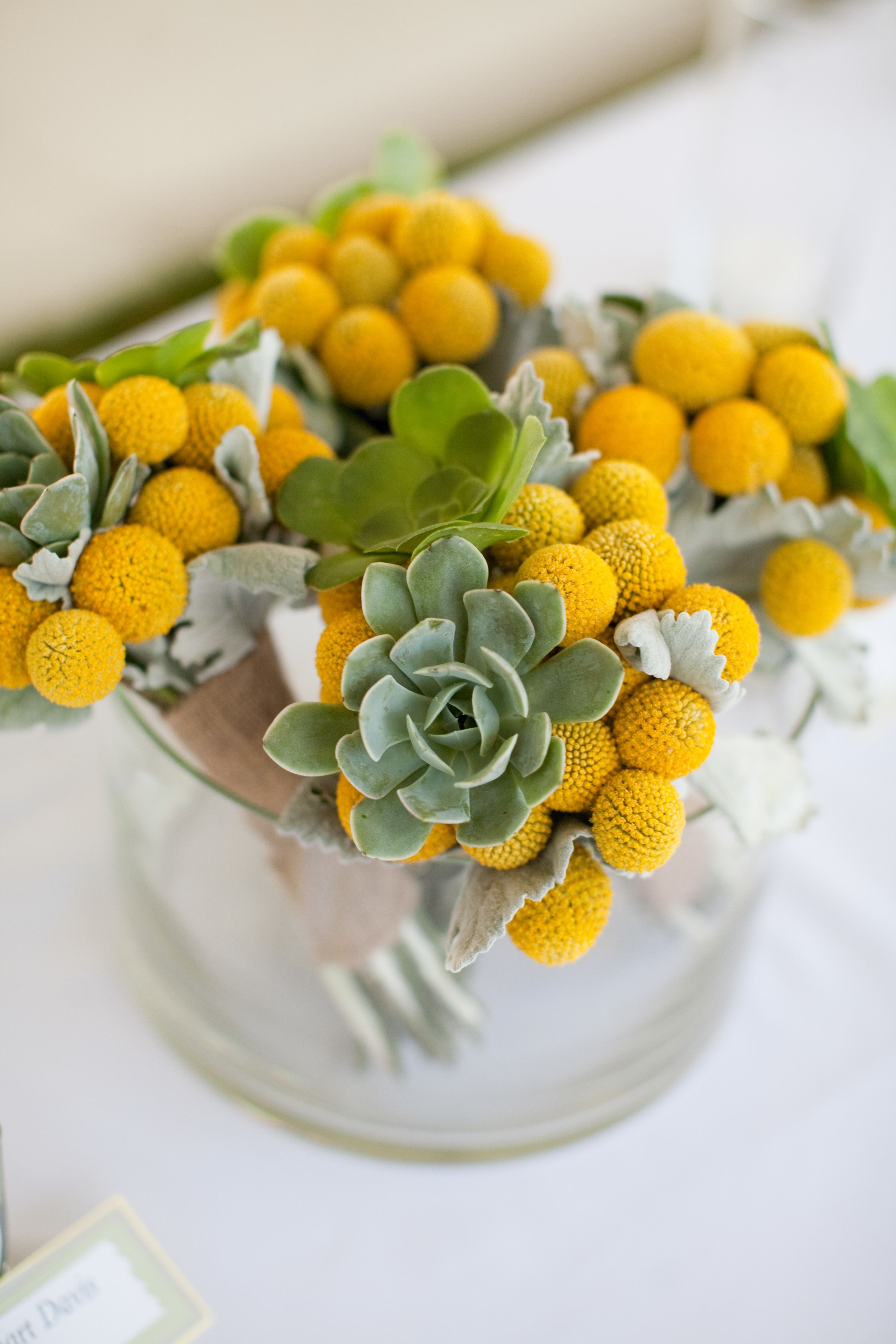 Centerpieces were made with the same flowers used in the bouquets ...