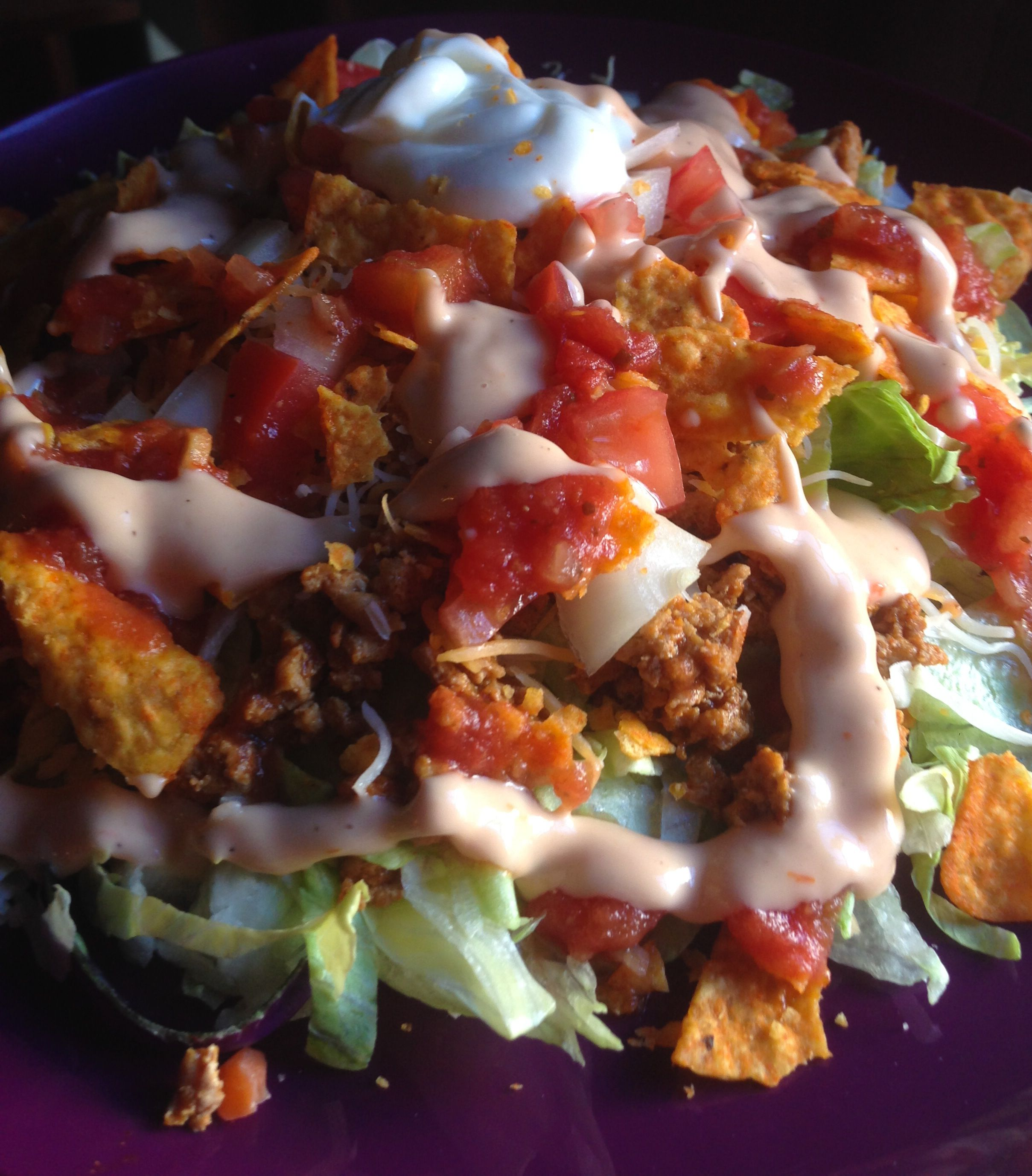 9 Points Plus - Doritos Taco Salad. Lettuce topped with taco seasoned ground turkey, reduced fat cheese, onions, tomatoes, fat free sour cream, salsa, Kraft Light Fiesta Salsa Ranch and of course Doritos. The family eats it as Doritos as the base and a little of the other toppings but I made the lettuce the base. So yummy!