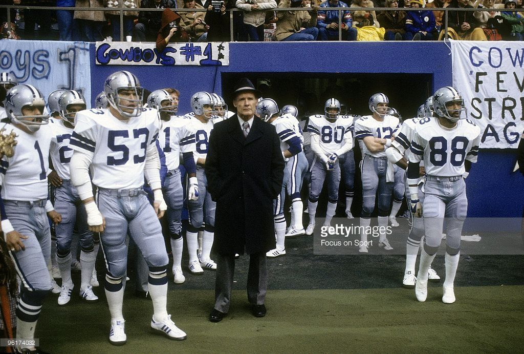 Head coach <a gi-track='captionPersonalityLinkClicked' href='/galleries/personality/240241' ng-click='$event.stopPropagation()'>Tom Landry</a> of the Dallas Cowboys hands in coat pocket waits with his team prior to the start of an early circa 1980s NFL football game against the New York Giants at Giant Stadium in East Rutherford, New Jersey. Landry coached the Cowboys from 1960-88.