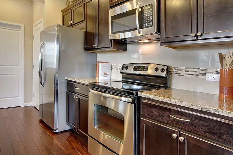 Stainless Steel Ge Slide In Electric Range With Matching Microwave Hood Over The