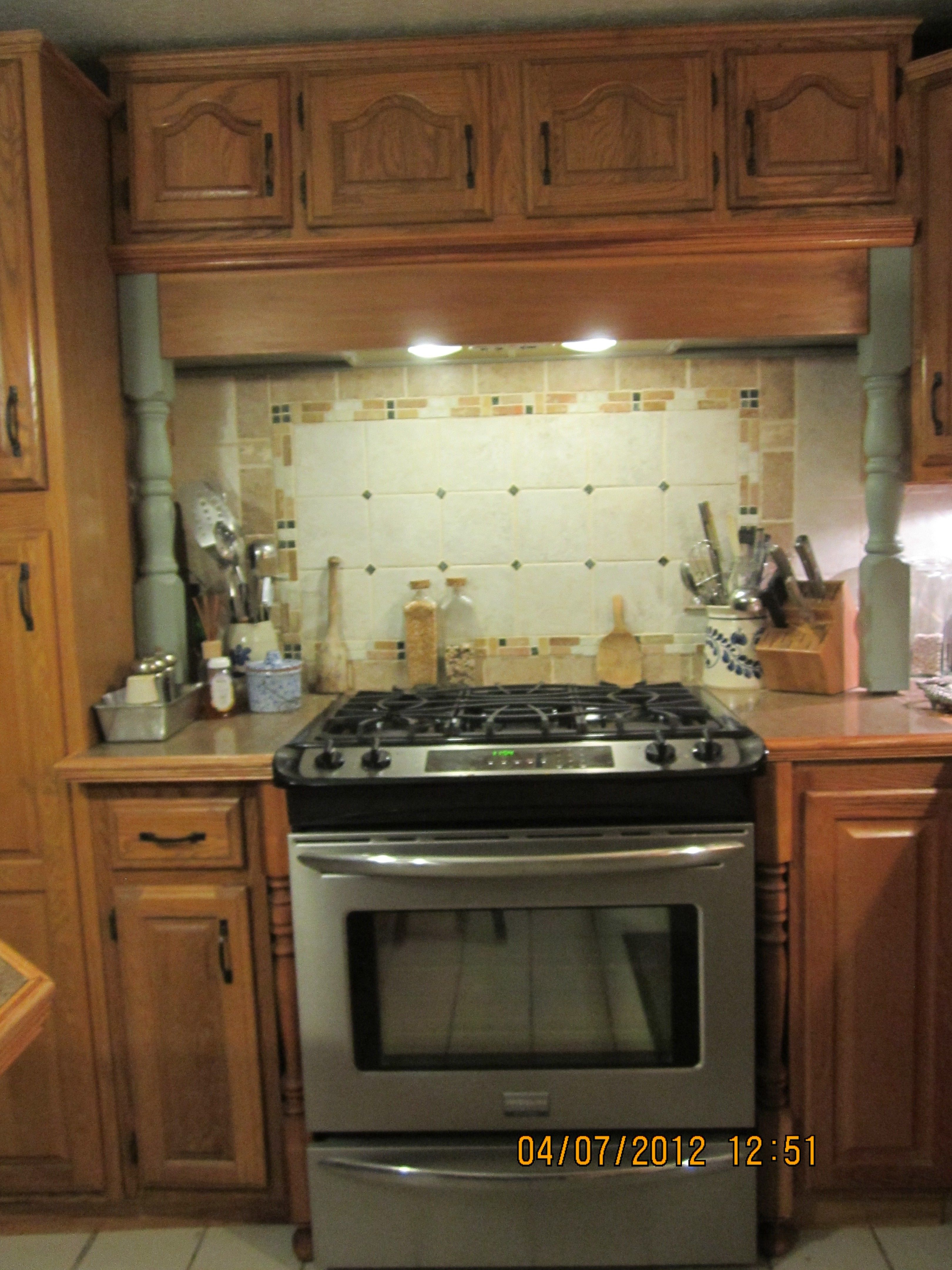 Rearranged cabinets & relocated fridge that used to be here & added a gas line to make this space for my new convection oven gas stove.