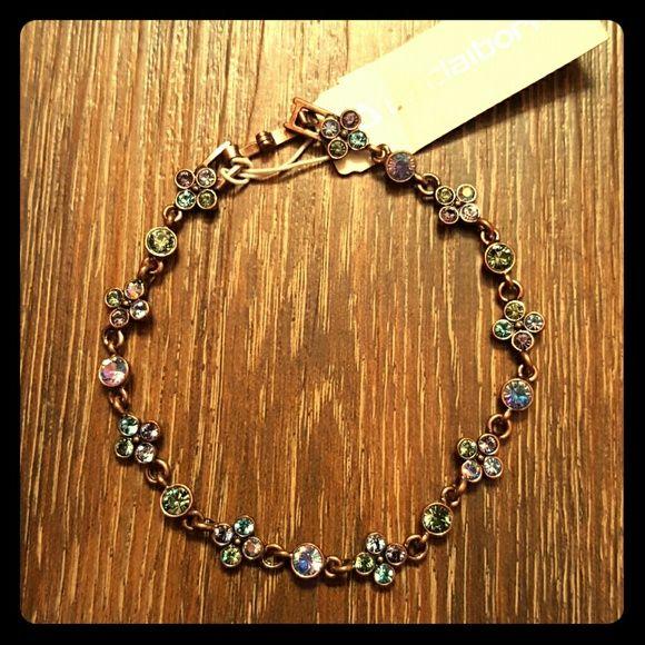 Elegant Bracelet Bronze in color with purple, blue, and green crystals. Liz Claiborne Jewelry Bracelets