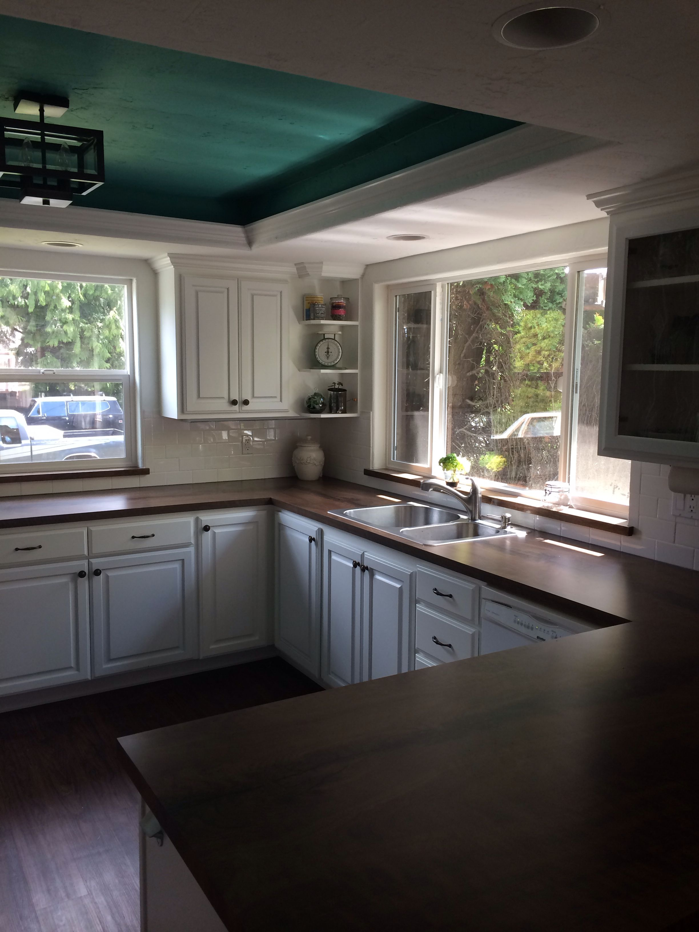 Kitchen with white cabinets white subway tile and for Black kitchen cabinets white subway tile