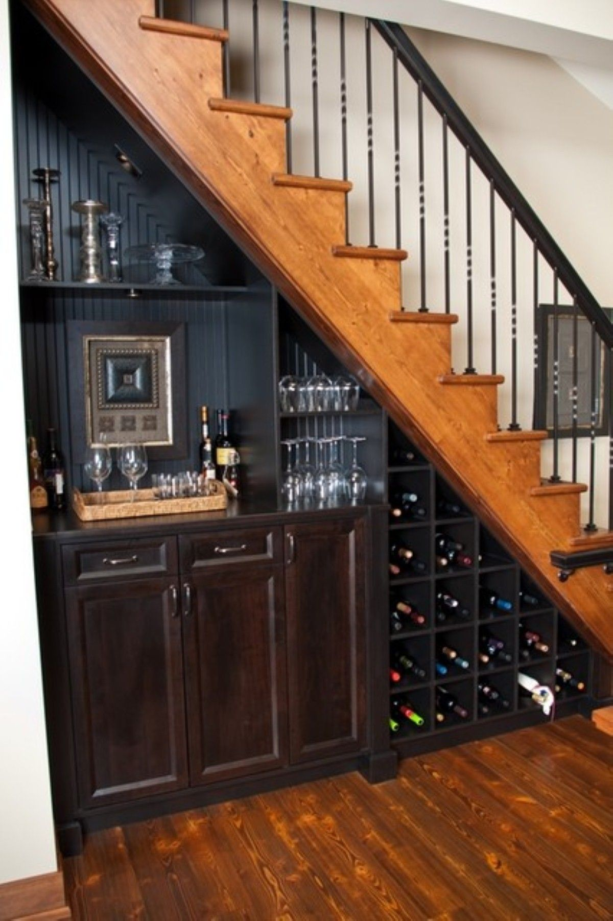 Fascinating dark black staircase design with dark wine storage under