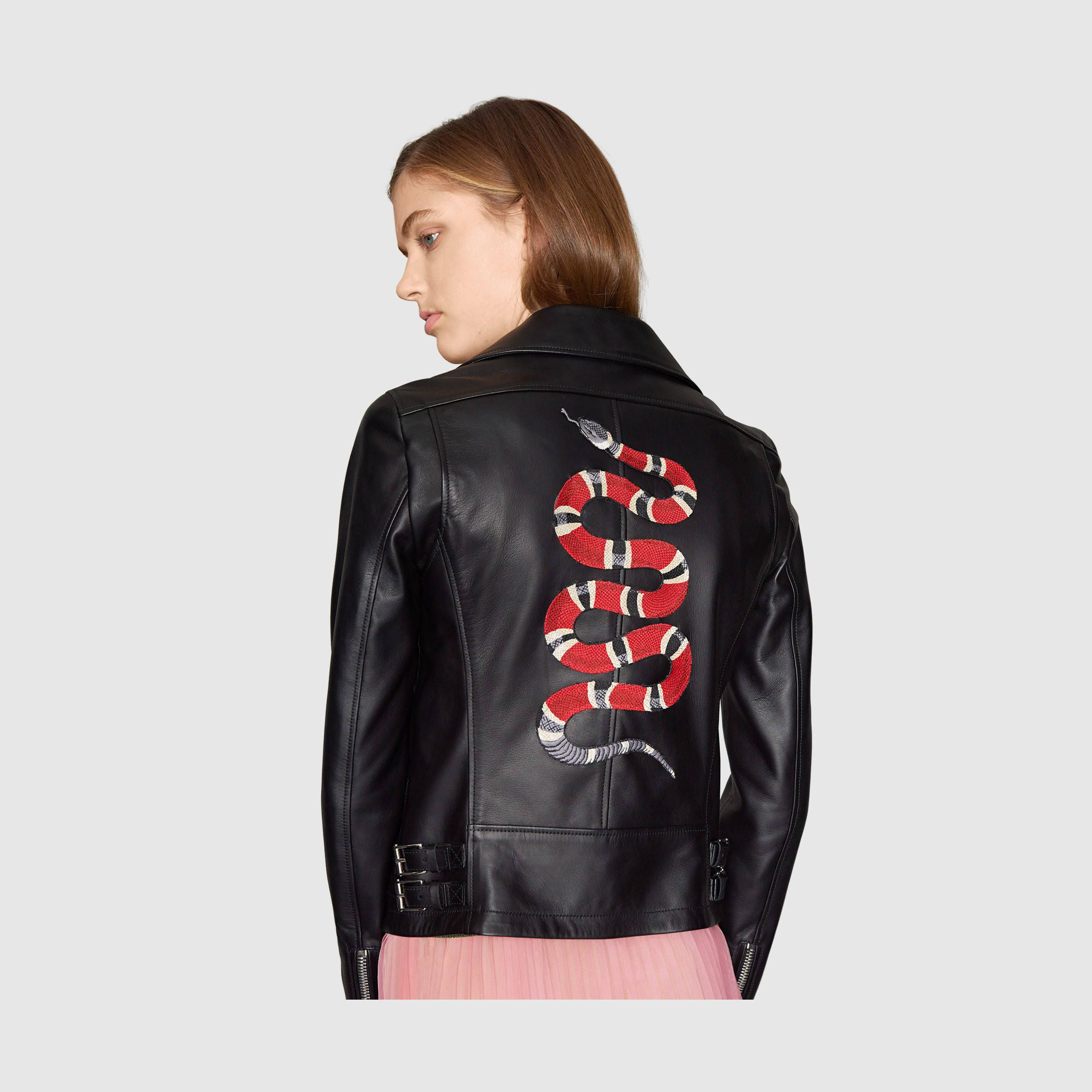 Leather jacket with appliqués by Gucci. A black leather