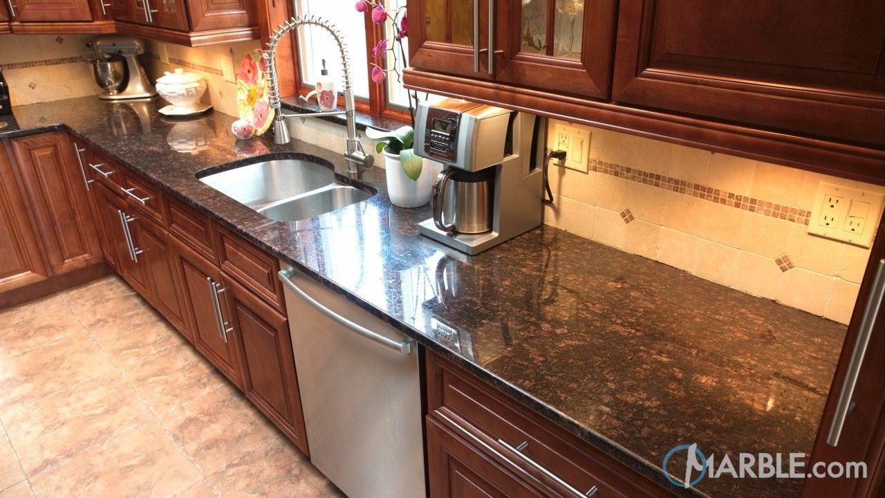 Kitchen Backsplash With Brow Cabinets And White Granite