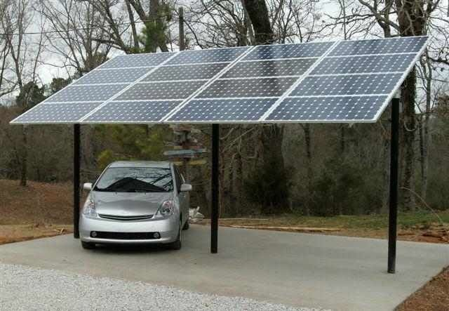 Solar car port no sense letting your electric car run your for Garage pole cover