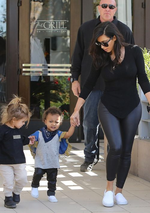 October 18, 2014 - Kim Kardashian, North West & Penelope Disick leaving The Grill