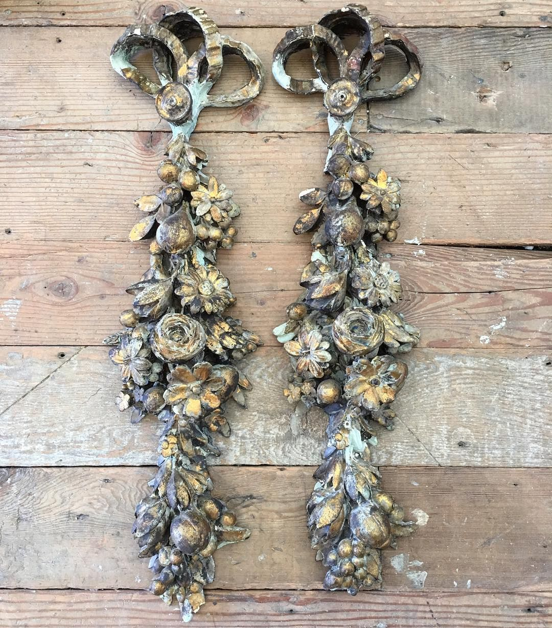 Beautiful pair of plaster wall plaques in french grey and chippy gilt.