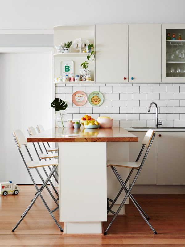 white and wood kitchen with coloured door knobs - cute! - via The