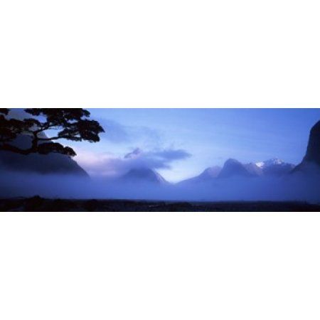 Fog over mountains Milford Sound Fiordland National Park South Island New Zealand Canvas Art - Panoramic Images (18 x 6)