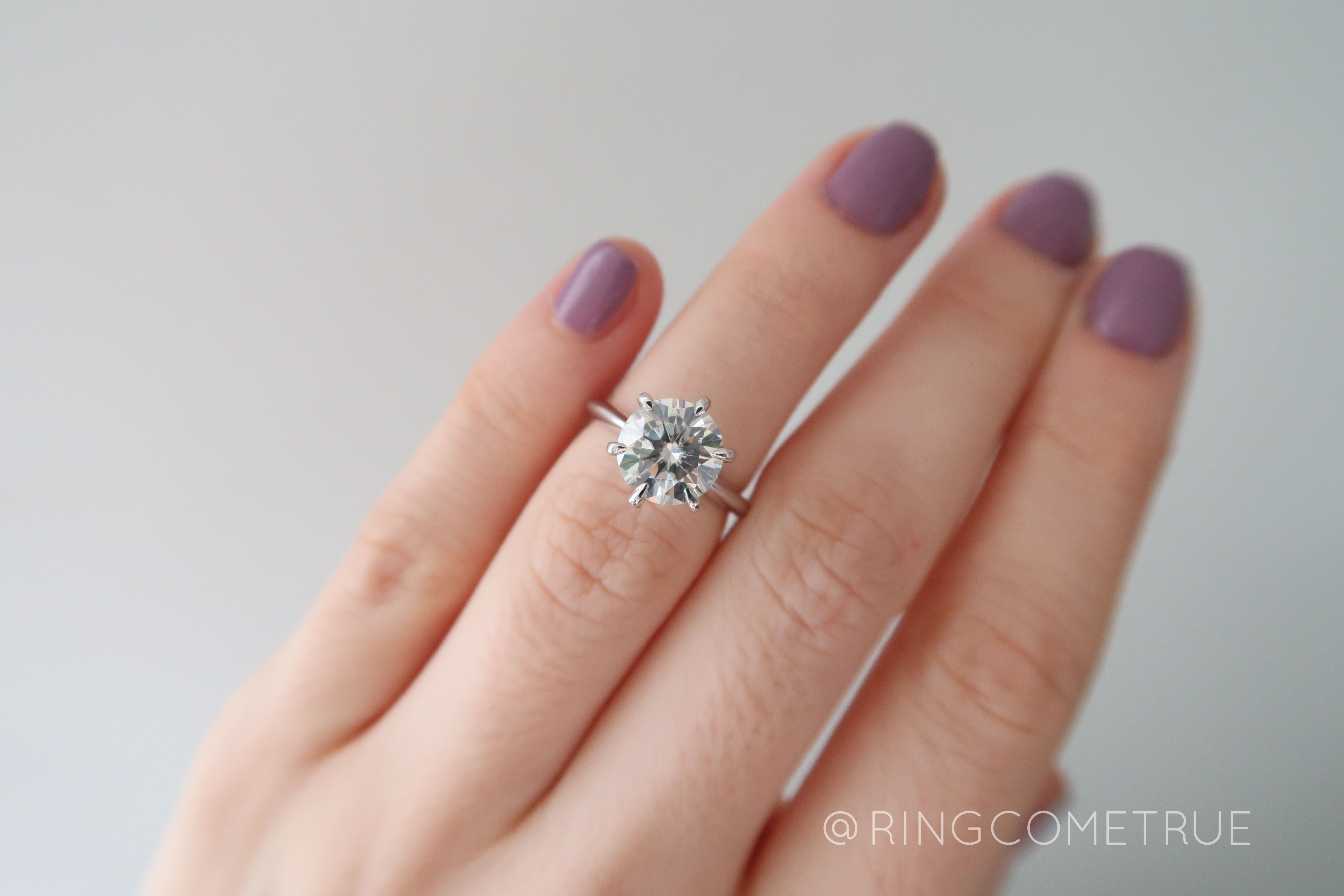 prong solitaire moissanite engagement ring white gold tiger claw