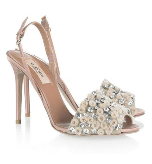 Valentino Pretty Little Rosettes wedding shoes  This is gorgeous rosettes wedding shoes from Valentino. The designer mixed shiny rhinestones with pretty little rosettes. Whether you have an outdoor or indoor wedding, this pair of Valentino wedding shoes which decorated with Pretty Little Rosettes and rhinestones can do well. Made out of tulle, satin and amazing little crystals, the nude Valentino wedding sandals must be your best choice for your wedding in summer.