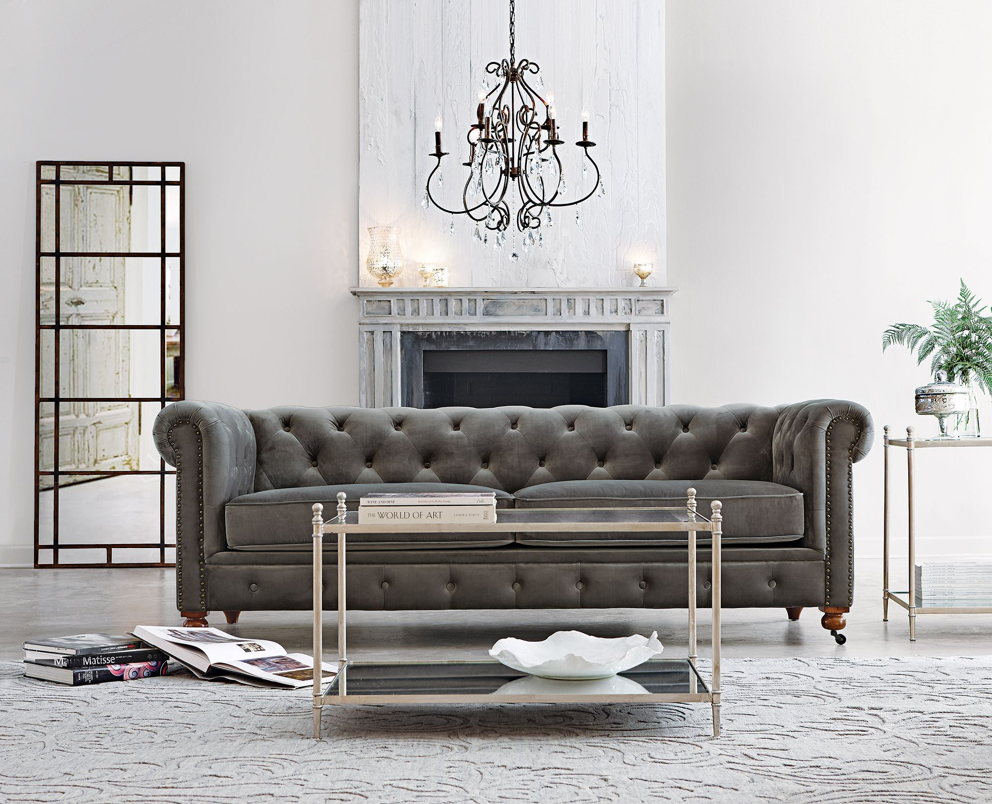 Our favorite Gordon Tufted Sofa now es in grey velvet just