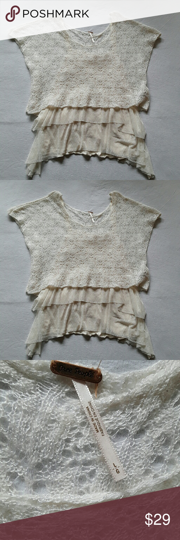 Free People Luna Twofer Layered Top size L Gently used, no rips, stains or tears, signs of light wash and wear. Cream colored camisole with a tiered ruffle lace camisole over it plus a cropped lace knit short sleeved top over that. Layers are sewn together at the shoulder seam.  Length at side seams ca.31 inches to ca. 29 inches in the middle. Chest across of stretchy cami piece ca 17 inches.The edges of the laces sections are left unfinished. Shell 42% rayon, 28% wool, 22% nylon, 8% alpaca…