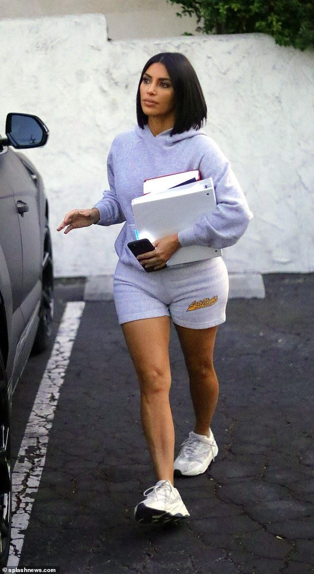 Kim Kardashian dresses down in shorts and a sweatshirt for class