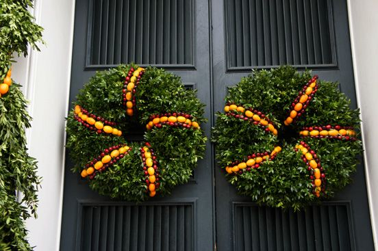 Kumquats, cranberries + boxwood on black