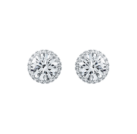Round Brilliant Micropavé Earstuds 2 round brilliant diamonds with a micropavé halo, total weight 3.50 carats; platinum setting.  Center sto...