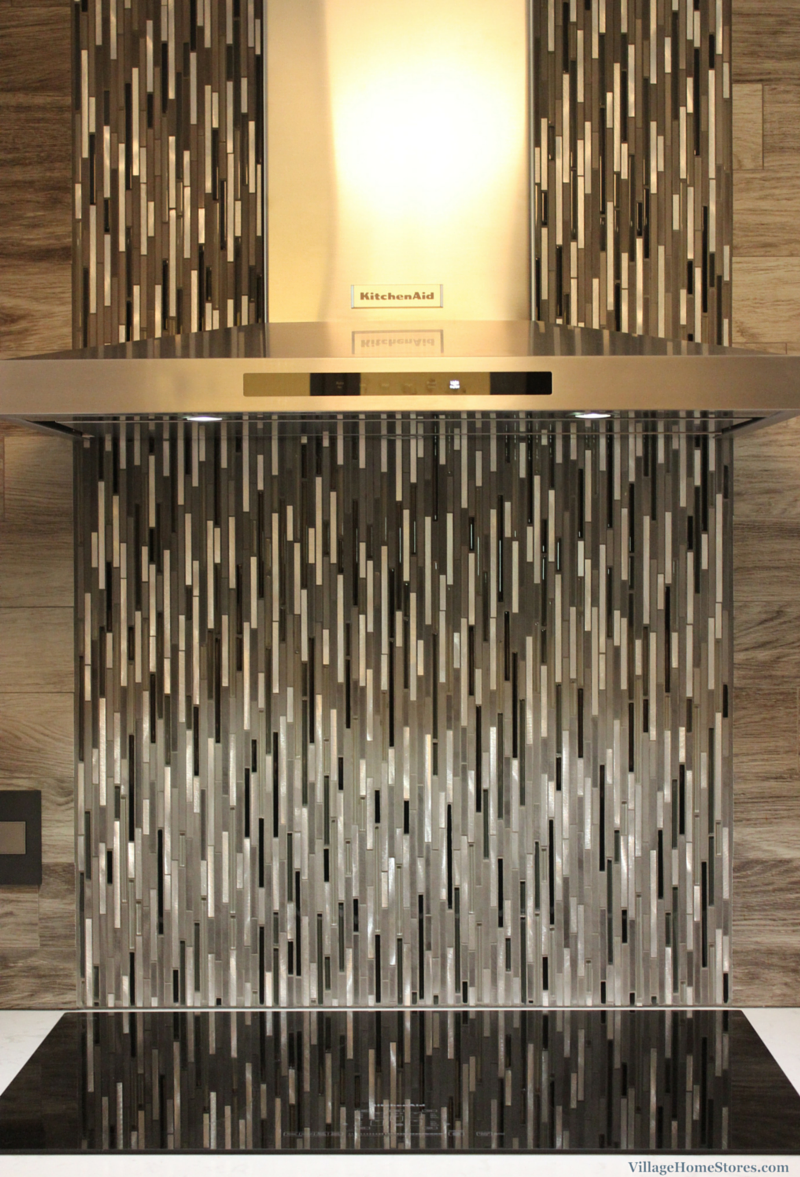 A Glazzio #mosaic tile cascades down behind a #stainless steel ...