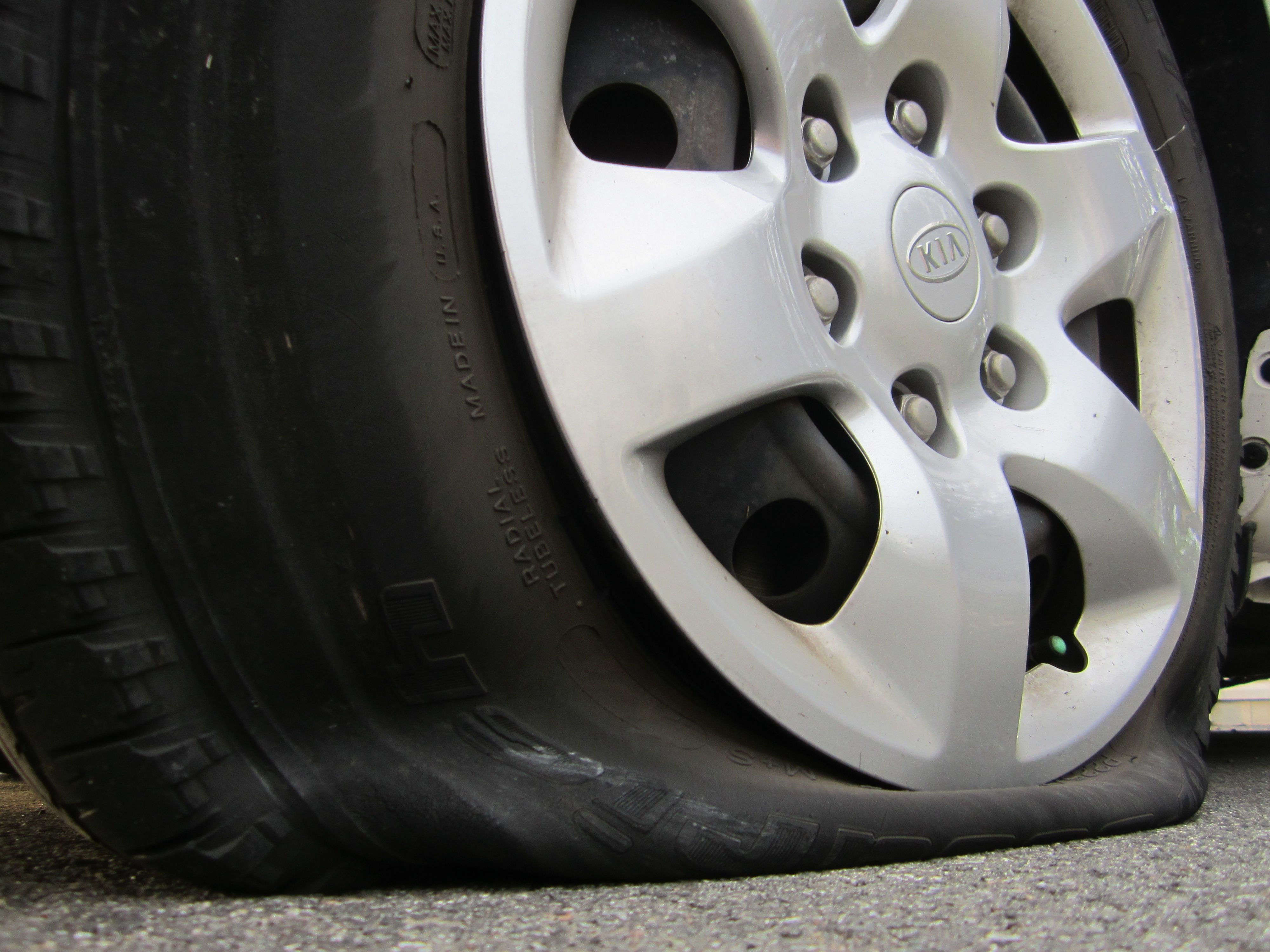 How To Change A Flat Tire Flat Tire Car Tire