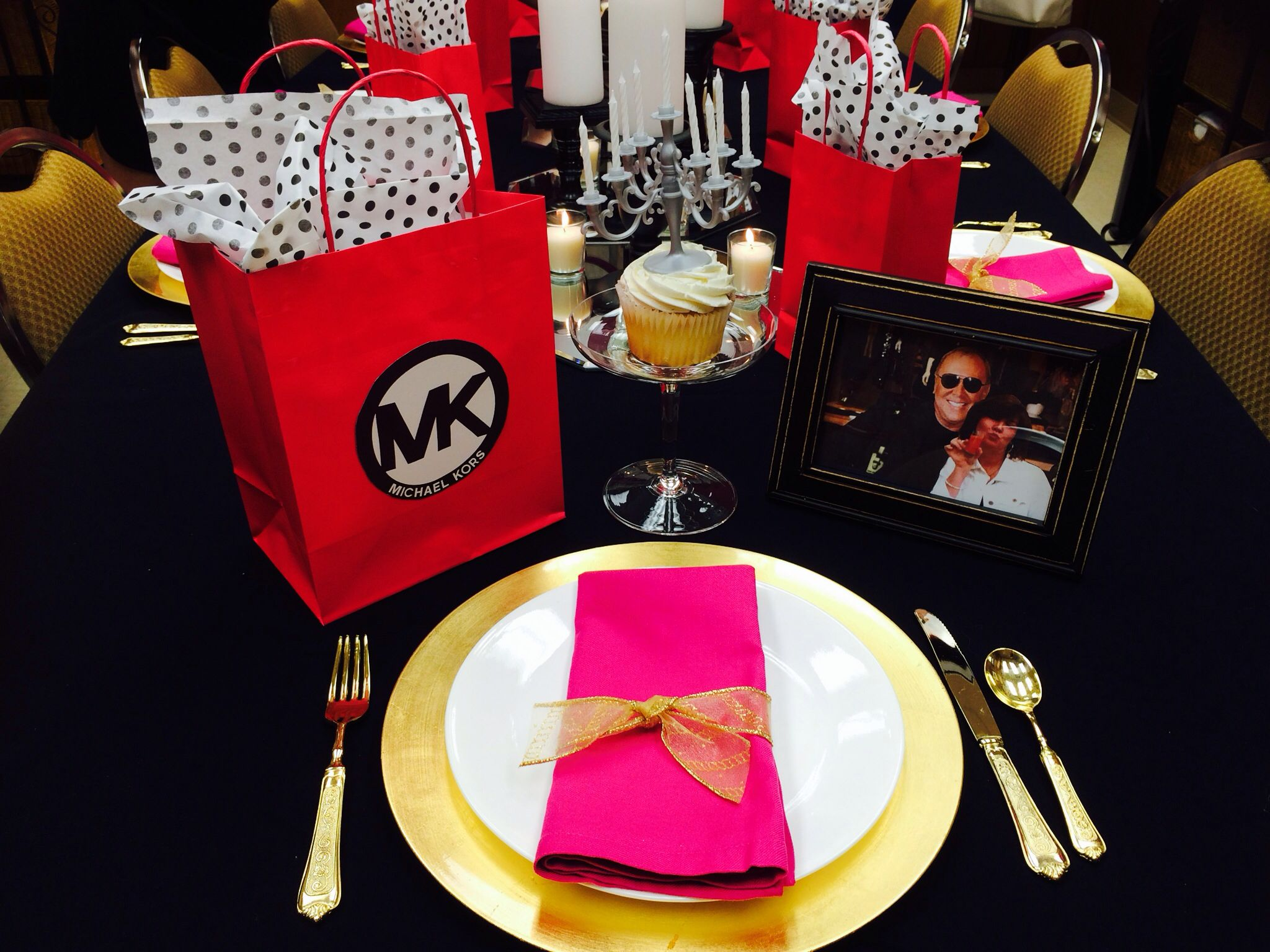 Michael Kors party theme in black gold and fuchsia