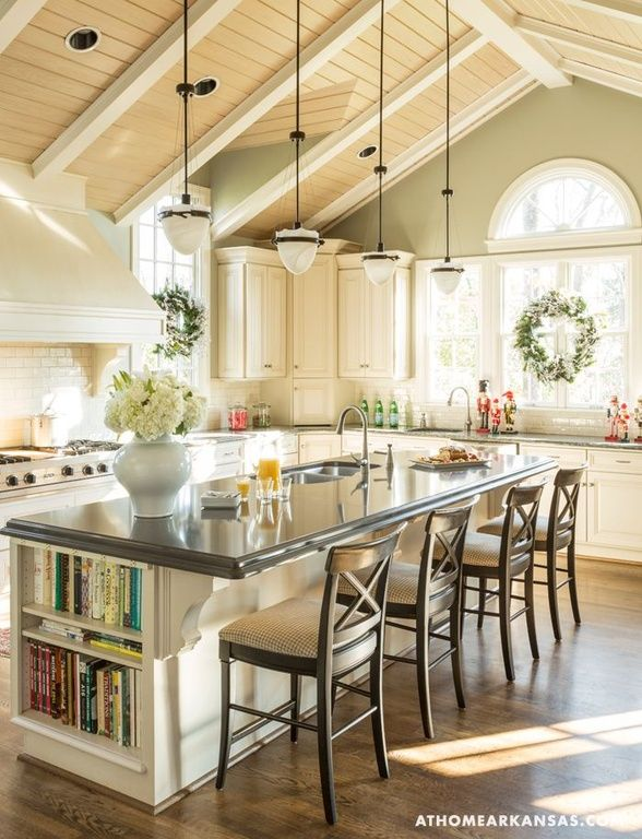 Bright country kitchen with large island and cathedral for Country kitchen island designs