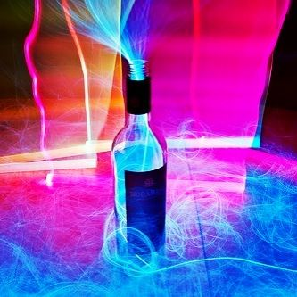 neon blue coming out of a bottle