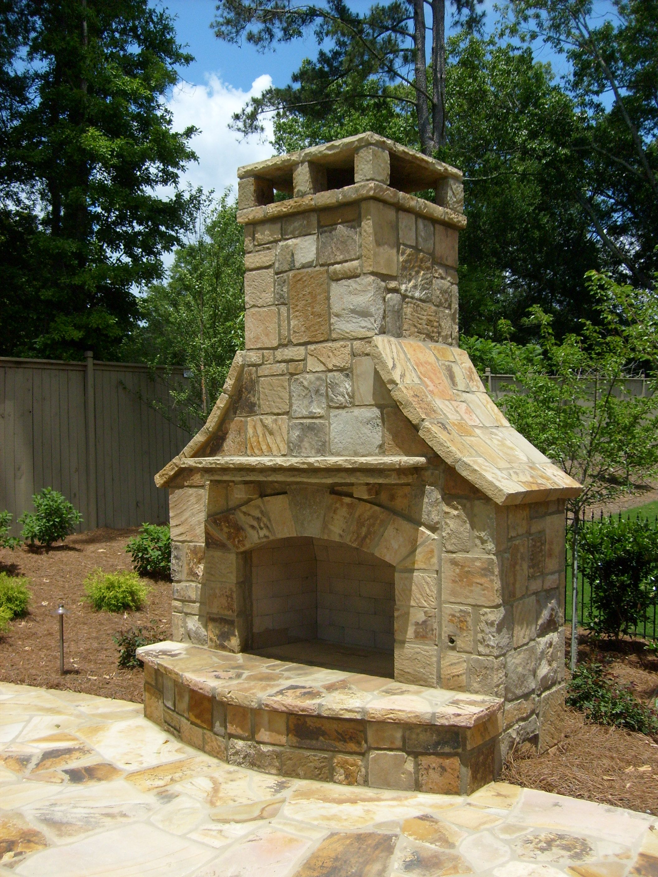 Outdoor Stack Stone Fireplace with flagstone decking ... on Simple Outdoor Brick Fireplace id=81211
