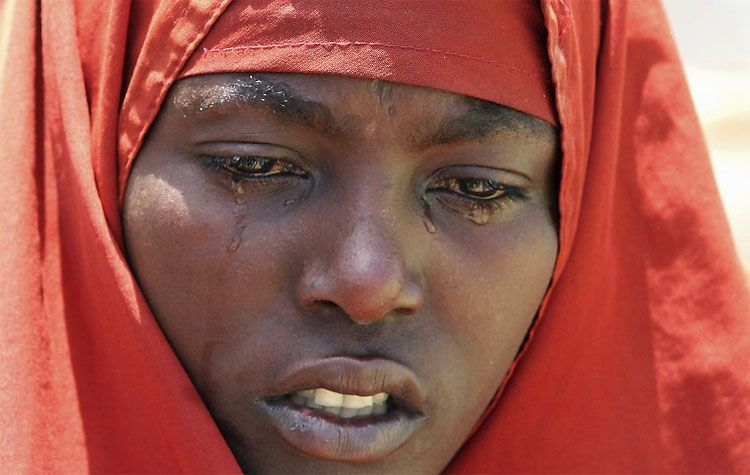 An internally displaced Somali woman mourns near the body of her son, who died of malnourishment, in Hodan district, south of Somalia's capital Mogadishu.
