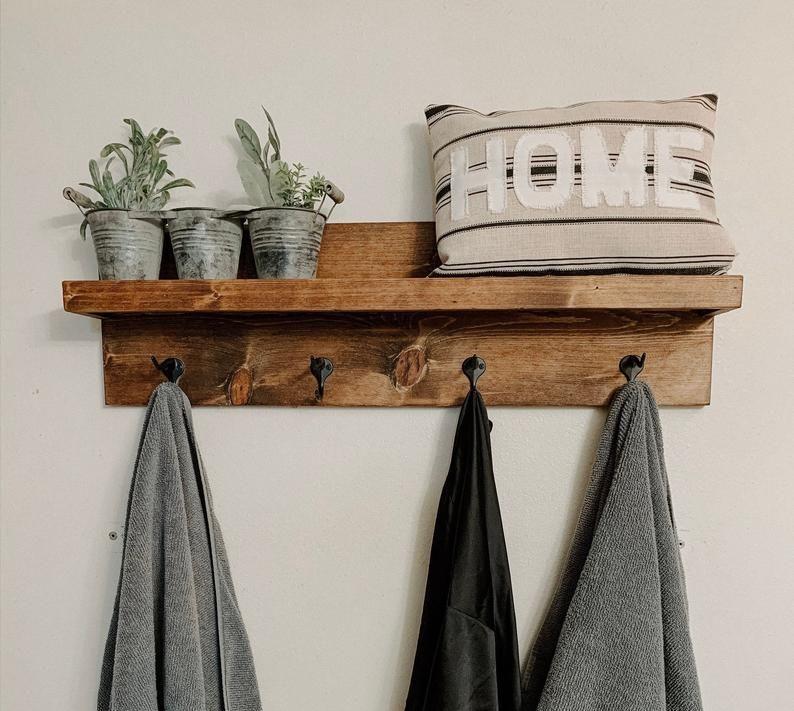bathroom shelf with towel hooks entry