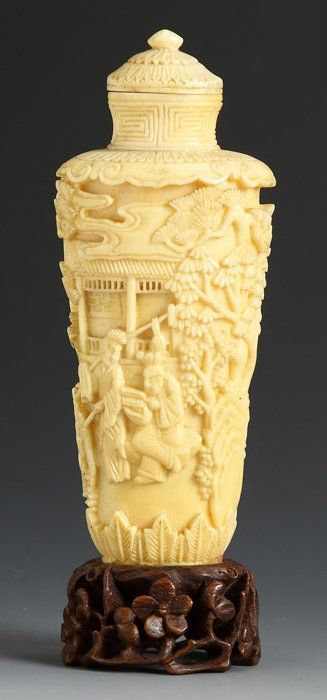"""Chinese Ivory Snuff Bottle. Cylindrical form, relief carved decoration of Chinese life. Ht. 4""""."""