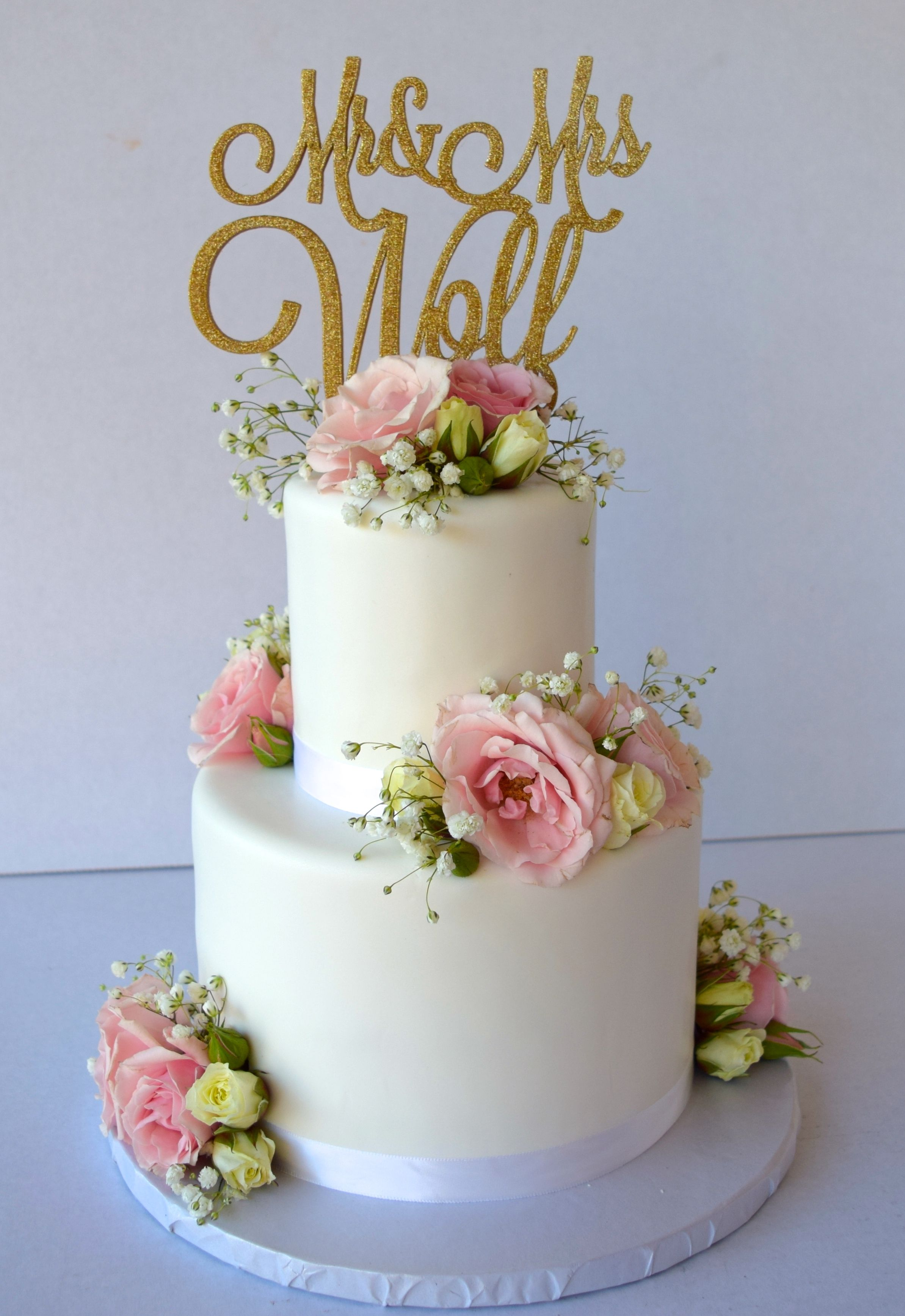 2 Tier White Wedding Cake With Blush Pink Roses On Each Tier And