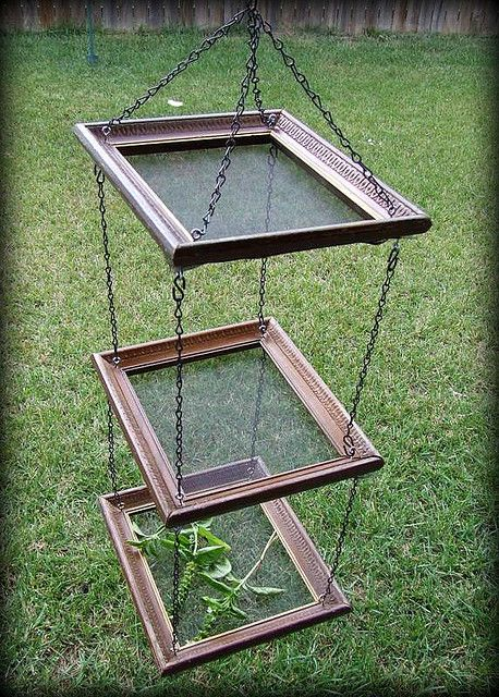 herb drying racks made from frames and screen.