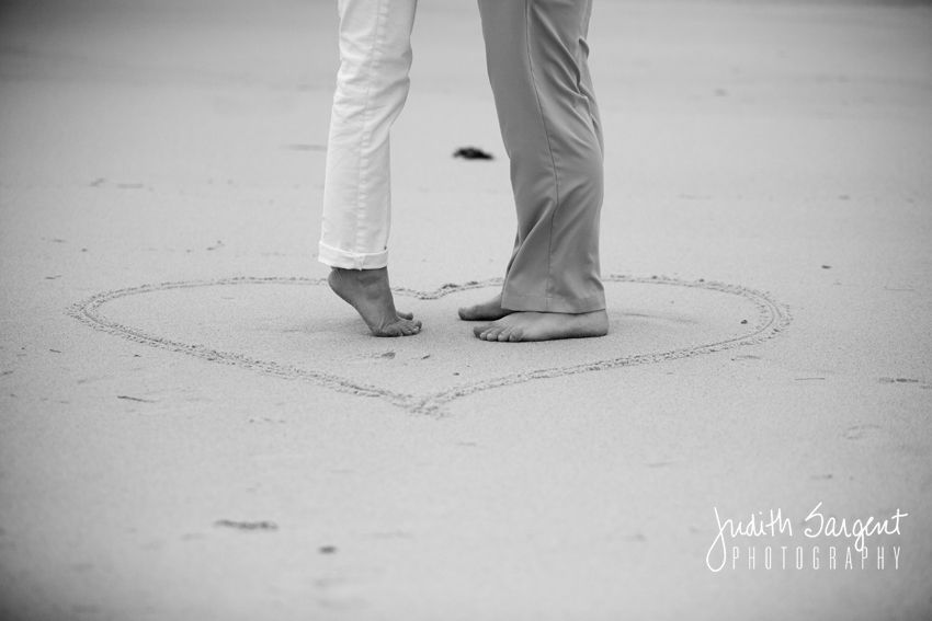 cute beach engagement photo idea from Judith Sargent Photography! Draw the date of the big day, or just a heart in the sand!