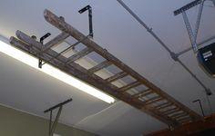 Extension Ladder Hanging Ideas The Garage Journal Board Garage Workshop Layout Ladder Storage Ladder