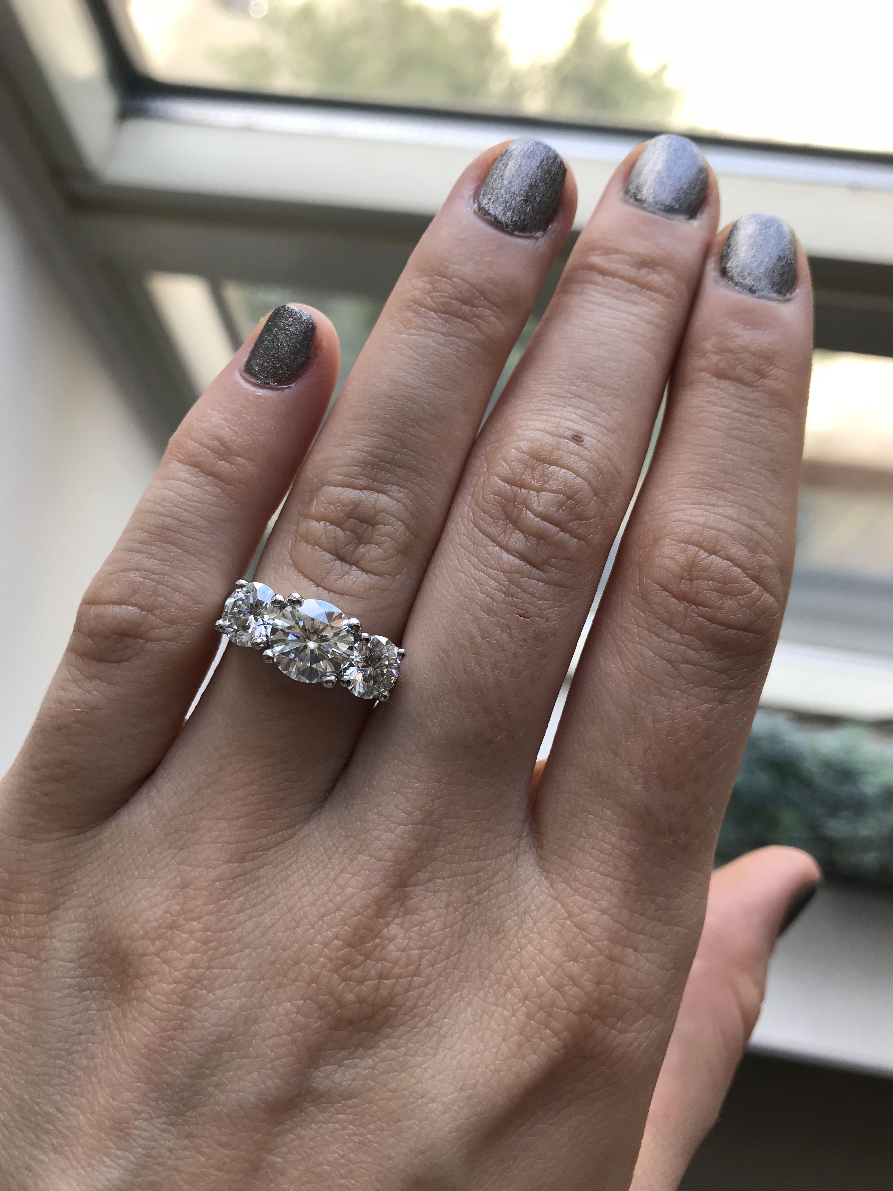 Classic three stone moissanite engagement ring platinum white gold
