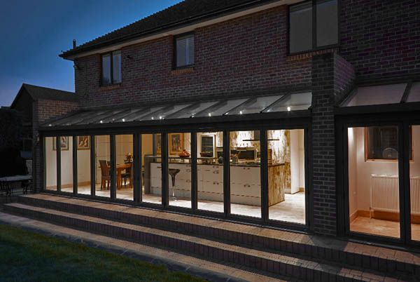 Open Plan Kitchen Ideas Uk open plan kitchen and dining room taken from outside at night time
