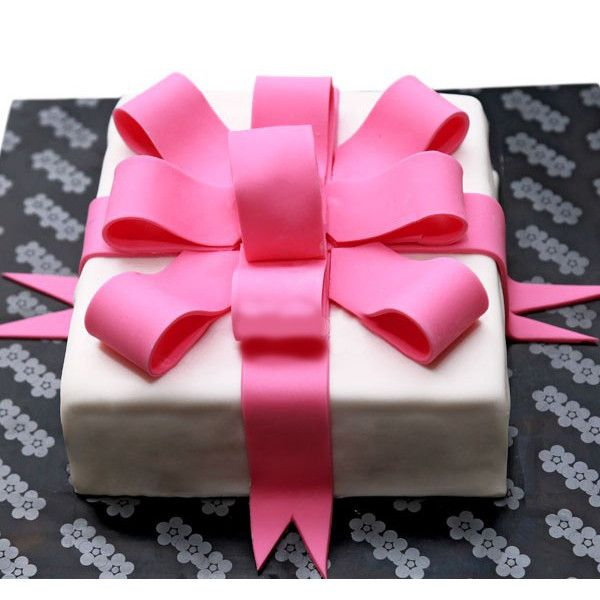 Gift Box Cake A Ribbon Cake Covered With Parchment Icing Send