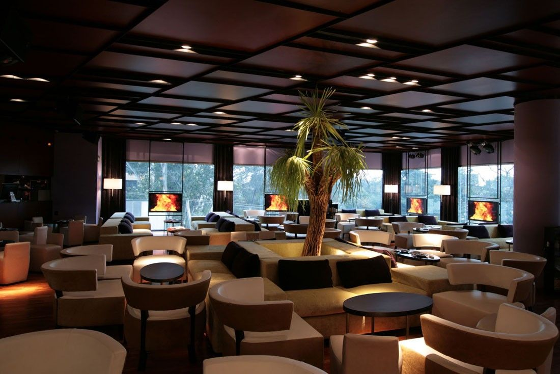 Elegant Bar And Lounge Design With Cream Fabric Round