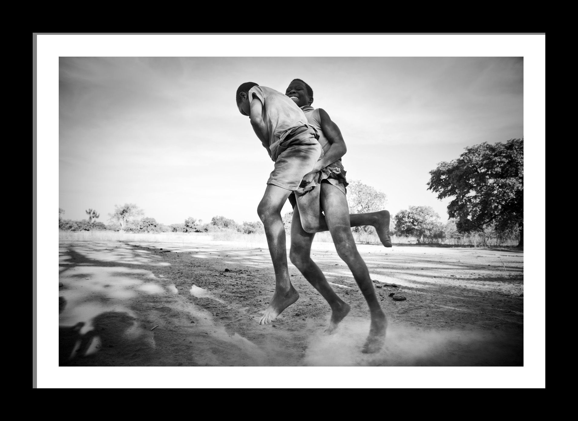 Boys wrestling the gambia west africa Fine art photography